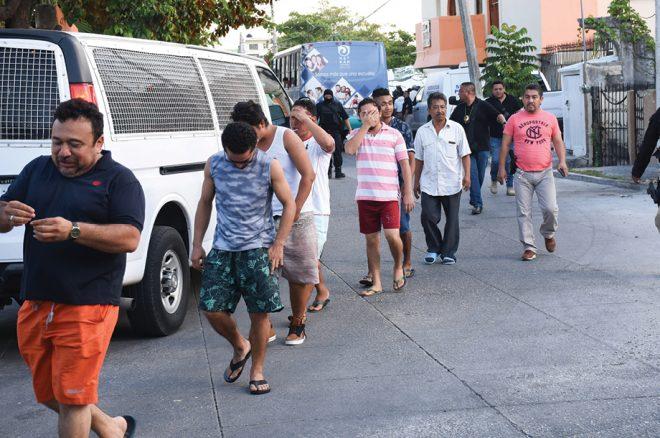 la Fiscalía estatal aseguró en un hotel a 61 indocumentados
